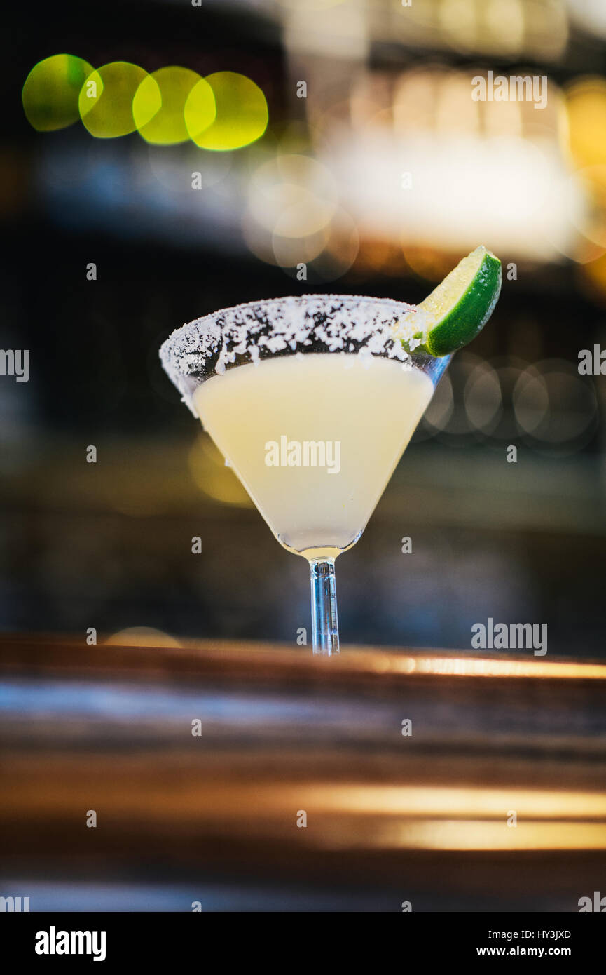Glass of Classic Margarita Cocktail with a Wedge of Lime - Stock Image