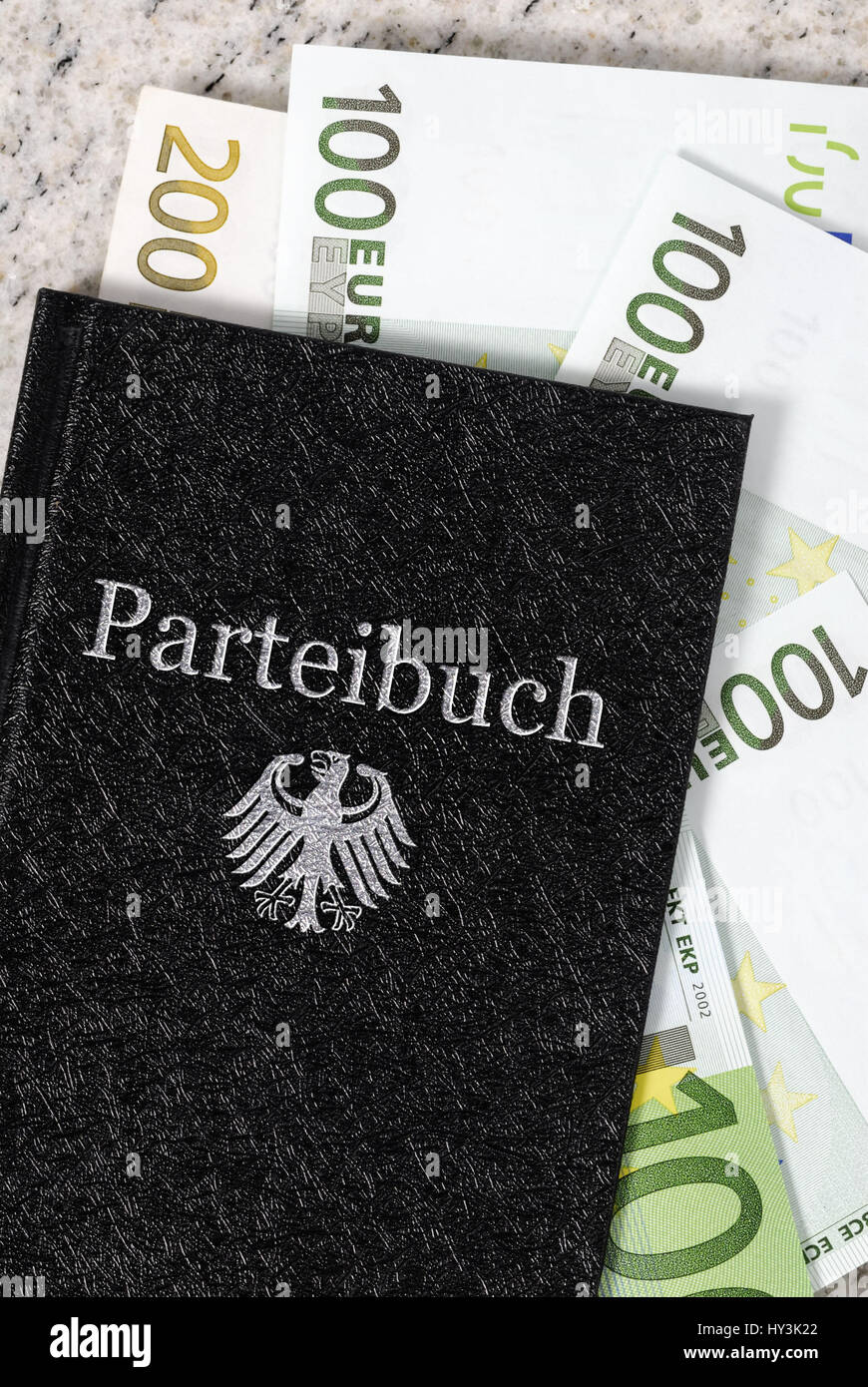 Party card with bank notes, income and additional incomes of politicians, Parteibuch mit Geldscheinen, Einkünfte - Stock Image