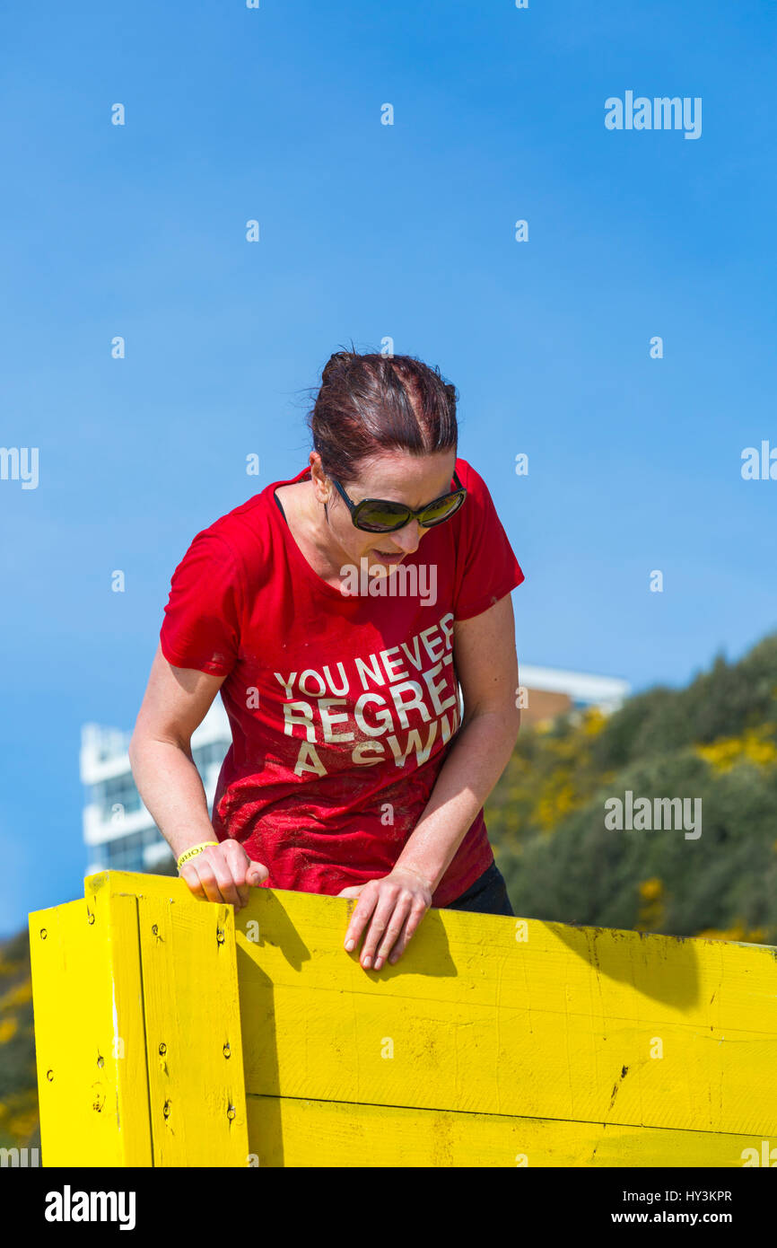 The coastal clamber obstacle, part of the Sandstorm Beach Challenge, on Bournemouth beach, a beach assault course - Stock Image