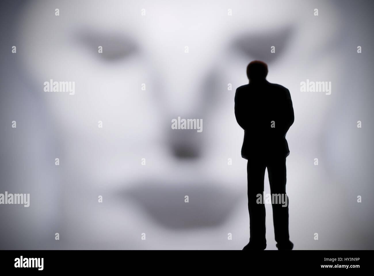Lonesome man before a distorted face, depression, Einsamer Mann vor einem verzerrten Gesicht, Depression - Stock Image