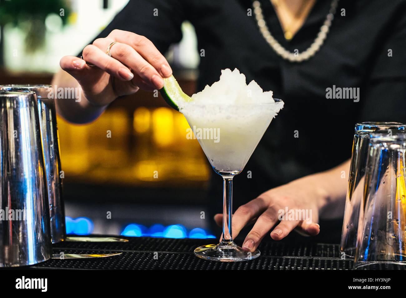 Bartender Preparing a Classic Margarita Cocktail with Crushed Ice - Stock Image