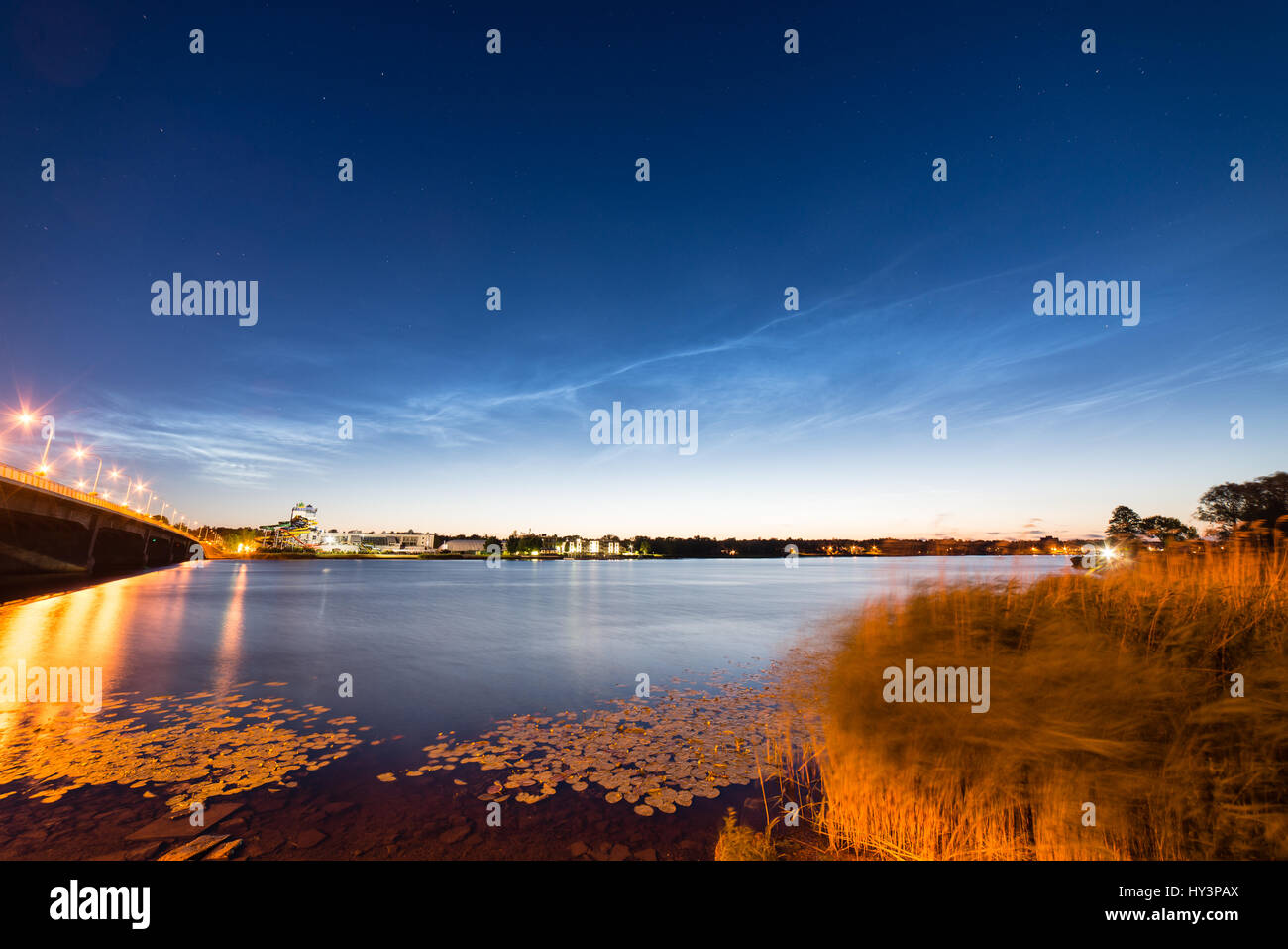 Beautiful sky phenomenon noctilucent clouds over beach in Latvia - Stock Image