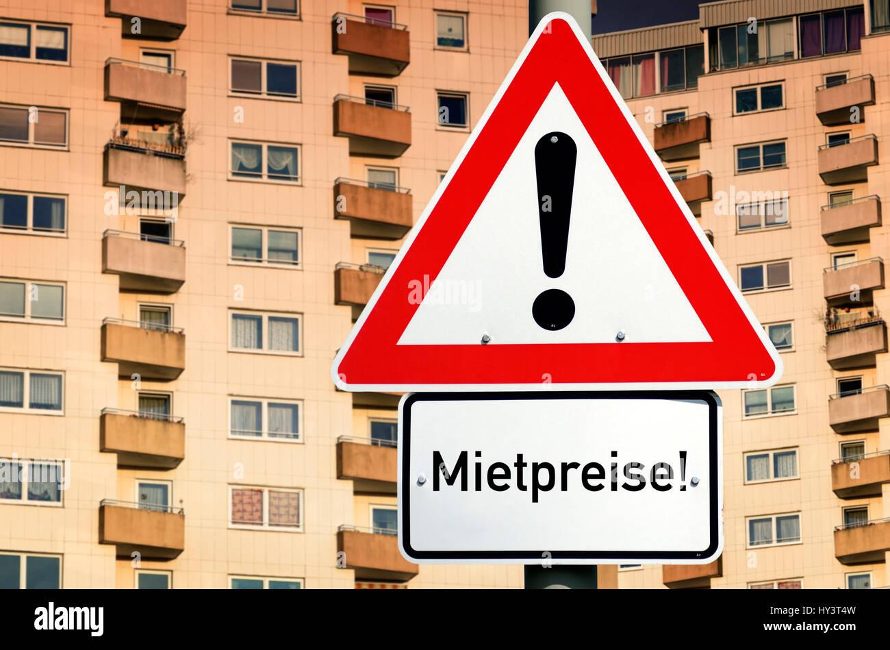 Sign with label Rent prices! before high rises, symbolic photo rent price brake, Schild mit Aufschrift Mietpreise! - Stock Image