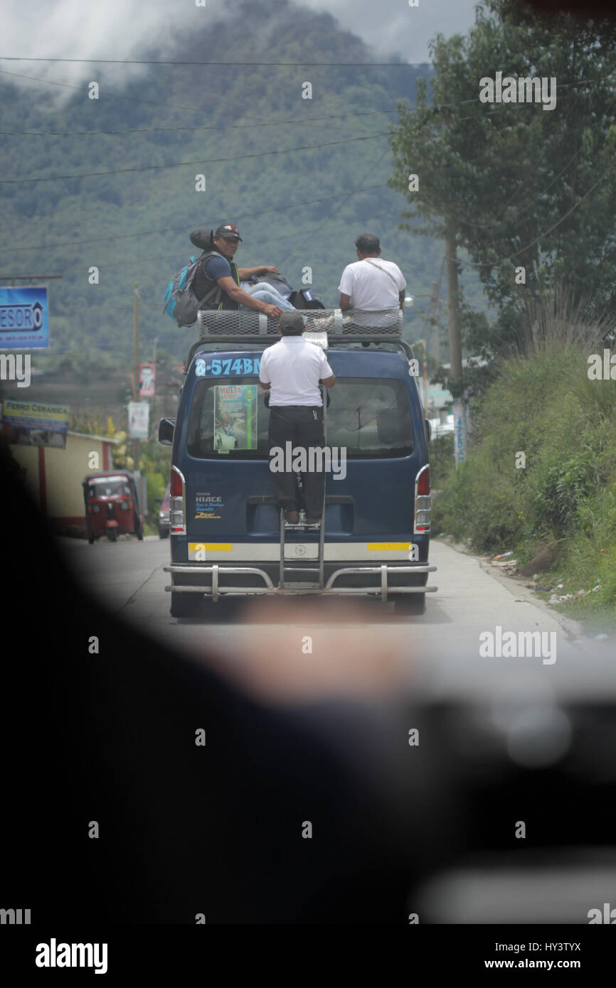 People in Guatemala traveling in trunk of pick up jeep - Stock Image