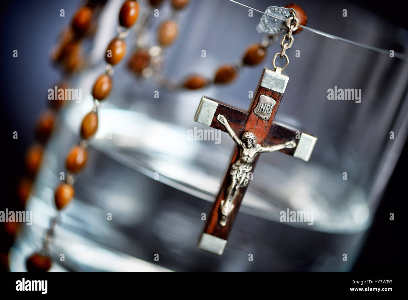 Water glass with cross, symbolic photo Sterbehilfe, Wasserglas mit Kreuz, Symbolfoto Sterbehilfe Stock Photo