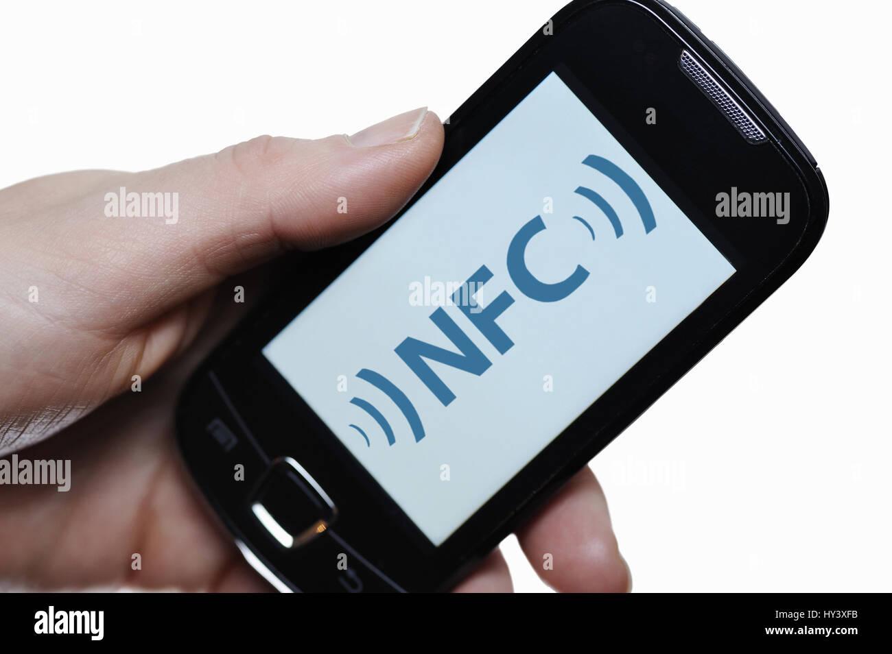Hand with smartphone, NFC, Near Field Communication, Hand mit Smartphone Stock Photo