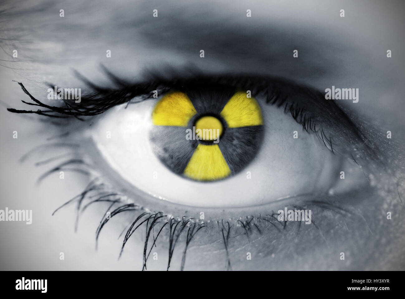 Eye of a woman with radioactivity sign, Auge einer Frau mit Radioaktivitaetszeichen Stock Photo