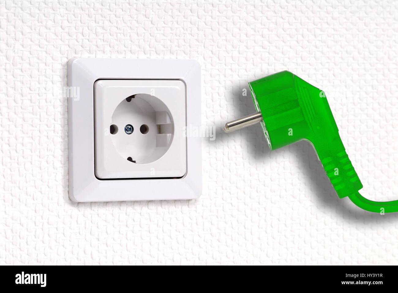 Outlet and green plug, ecological stream, Steckdose und gruener Stecker, oekostrom - Stock Image