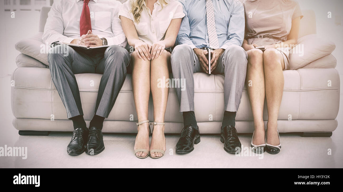Portrait of executives waiting for job interview in office - Stock Image