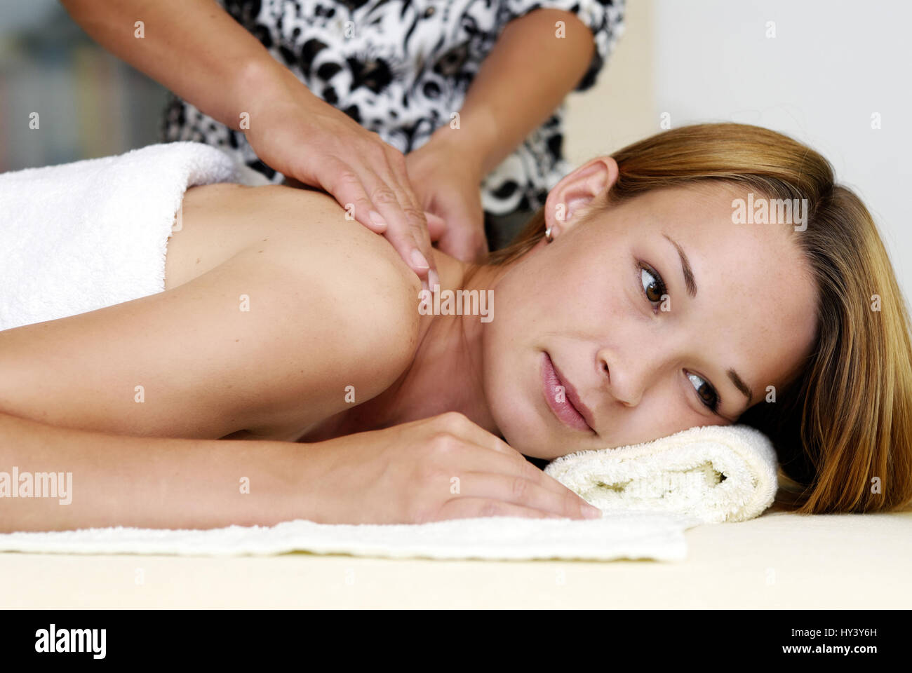 Young woman with massage treatment, Junge Frau bei Massagebehandlung Stock Photo