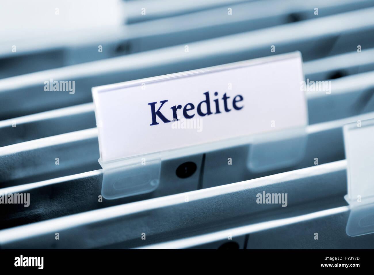 Rider on a slope folder with the label Loans, Reiter auf einem Haengeordner mit der Aufschrift Kredite Stock Photo