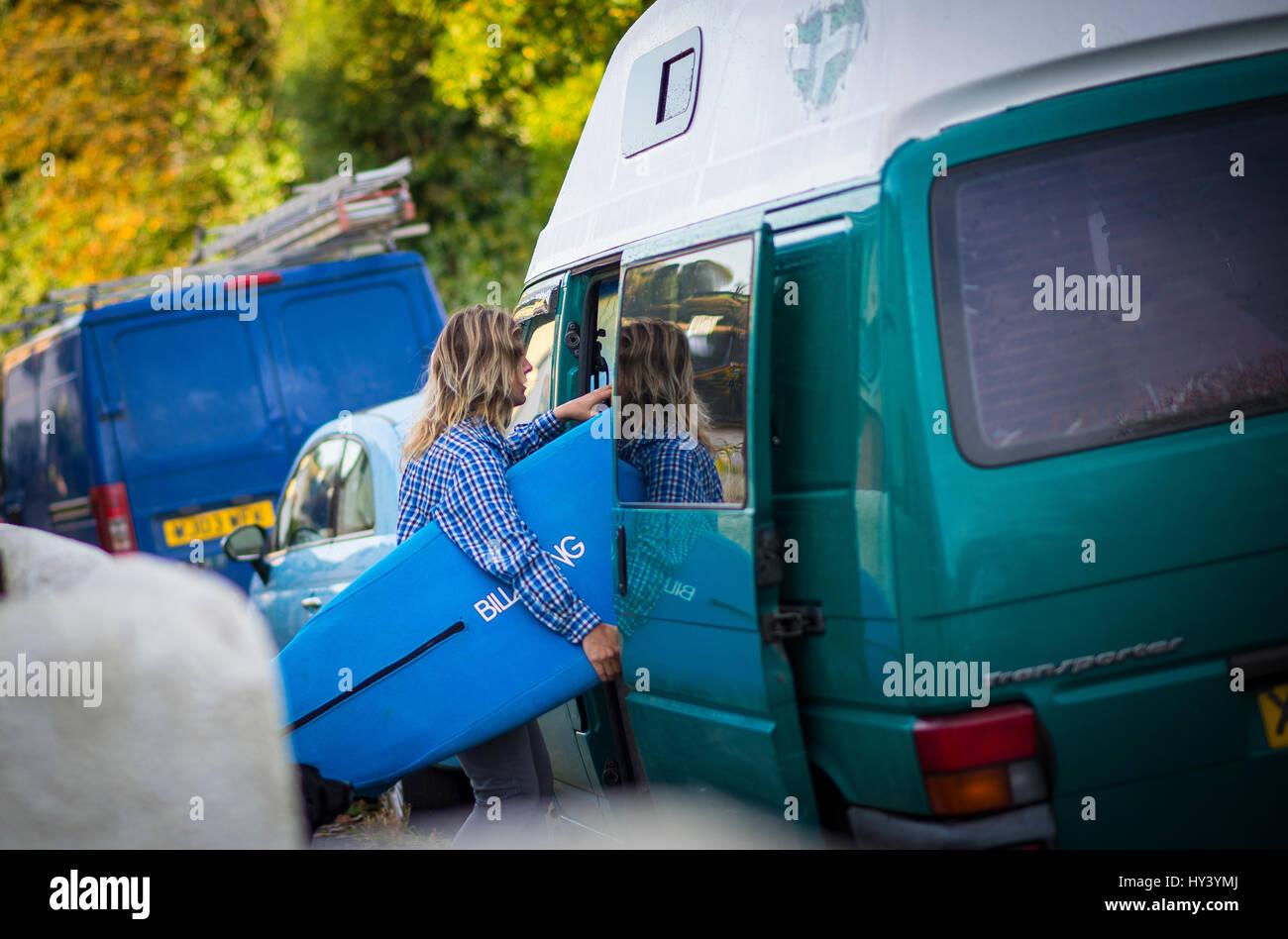 Loading up the Volkswagon camper van for a surf session at Bantham Beach, Devon, England, UK - Stock Image