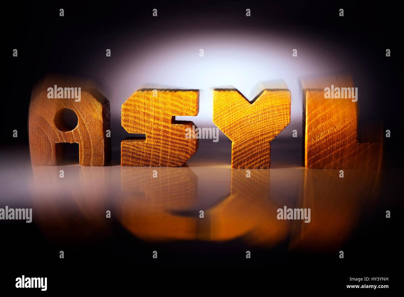 The word Asylum from wooden letter, Das Wort Asyl aus Holzbuchstaben - Stock Image
