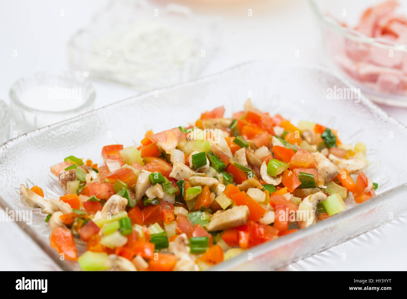 Omelet preparation : Freshly sauteed vegetables - Stock Image
