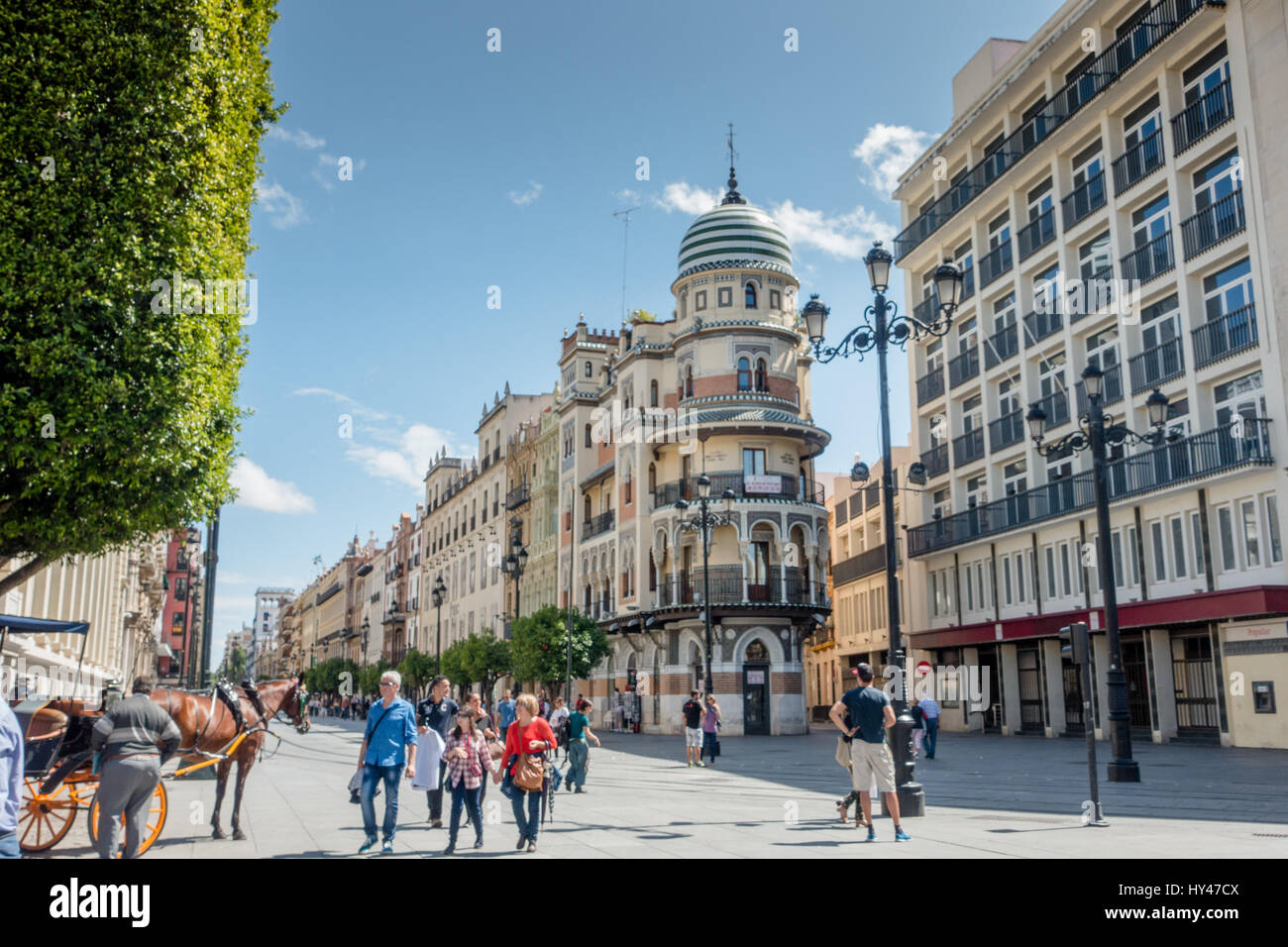 SEVILLE, SPAIN - JUNE 1, 2016: People and buildings on a beautiful day in Seville, Spain. Stock Photo