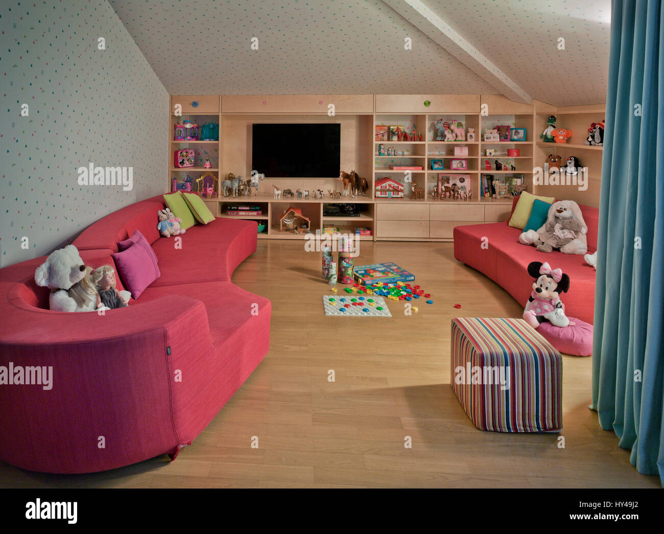 Interior design in the children's room. shelves with toys. Domestic comfortable life. Stock Photo