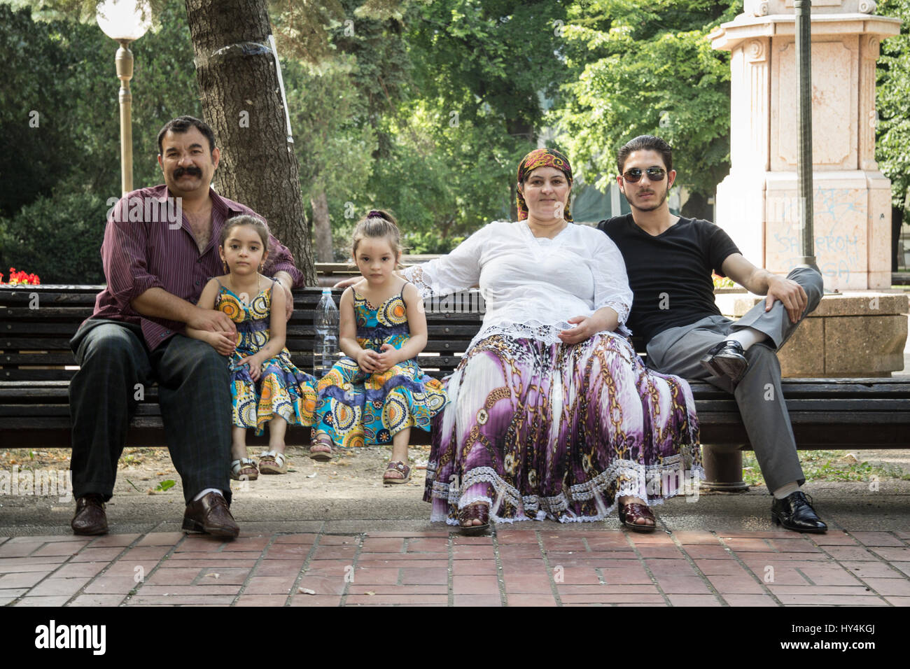 PANCEVO, SERBIA - JUNE 13, 2015: Portrait of a Roma family wearing traditional costumes  Picture of a Roma family - Stock Image