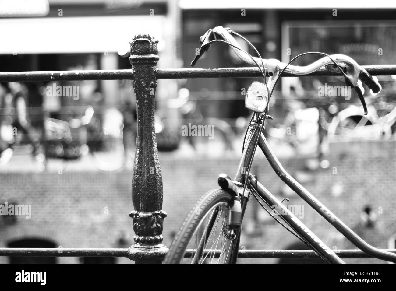 parked bicycle on a railing in Utrecht Stock Photo