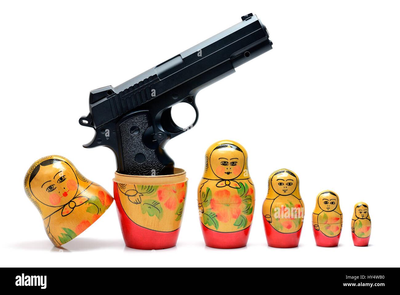 Russian Matroschka with gun, Russische Matroschka mit Pistole Stock Photo