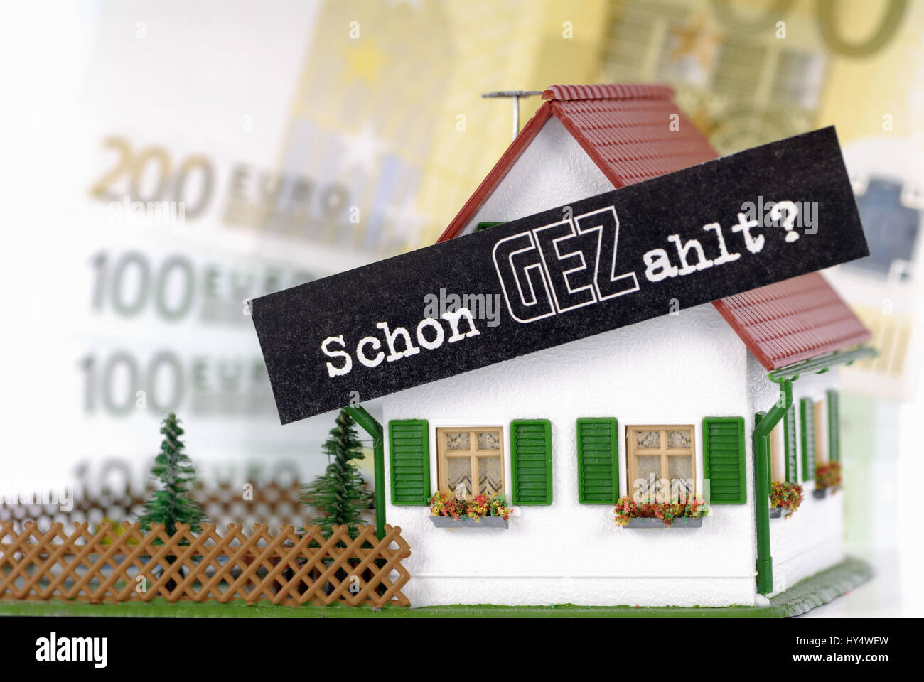 Miniature house with GEZ slogan Already Paid fees GEZ per household, Miniaturhaus mit GEZ-Slogan Schon GEZahlt GEZ Stock Photo