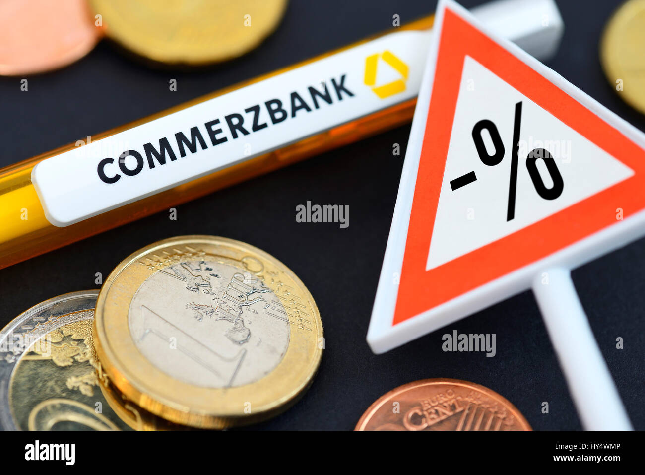 Warning with negative percent sign and Commerzbank ballpoint pen, symbolic photo negative interest, Warnschild mit Stock Photo