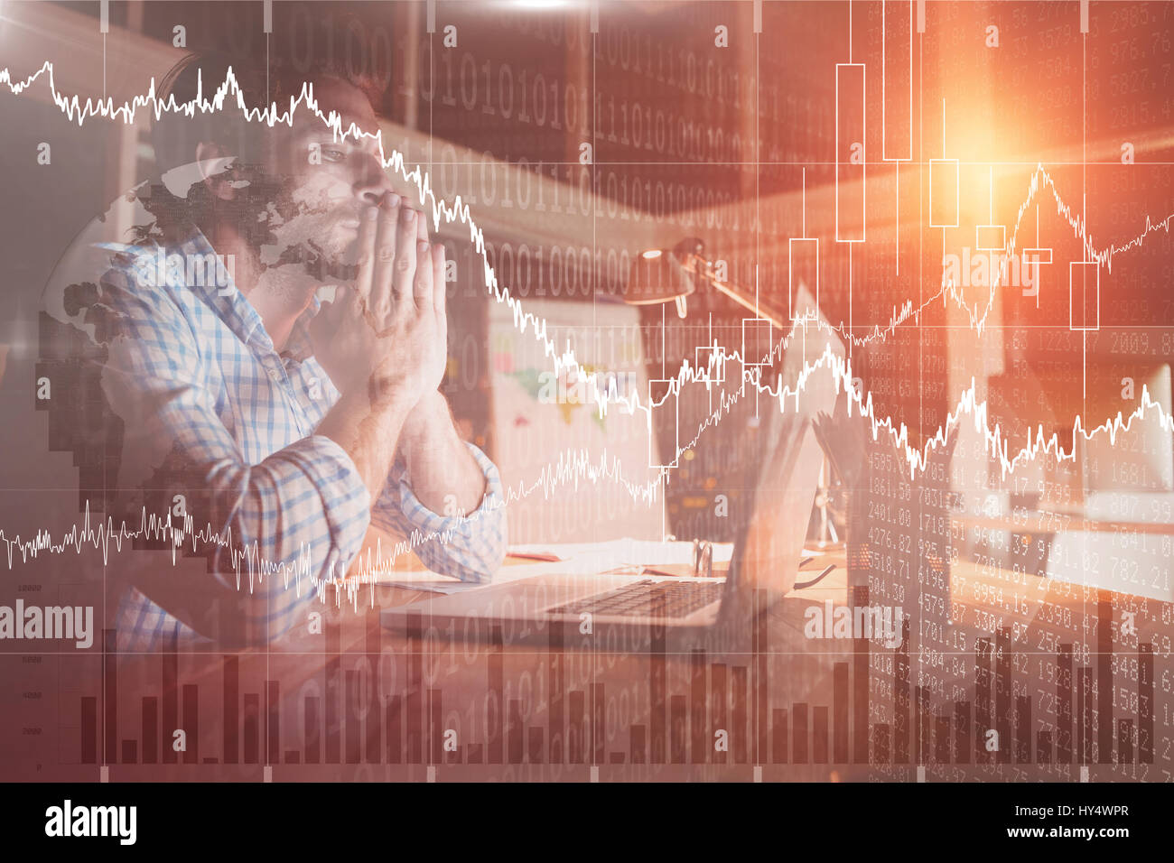 Stocks and shares against overworked businessman working at night - Stock Image