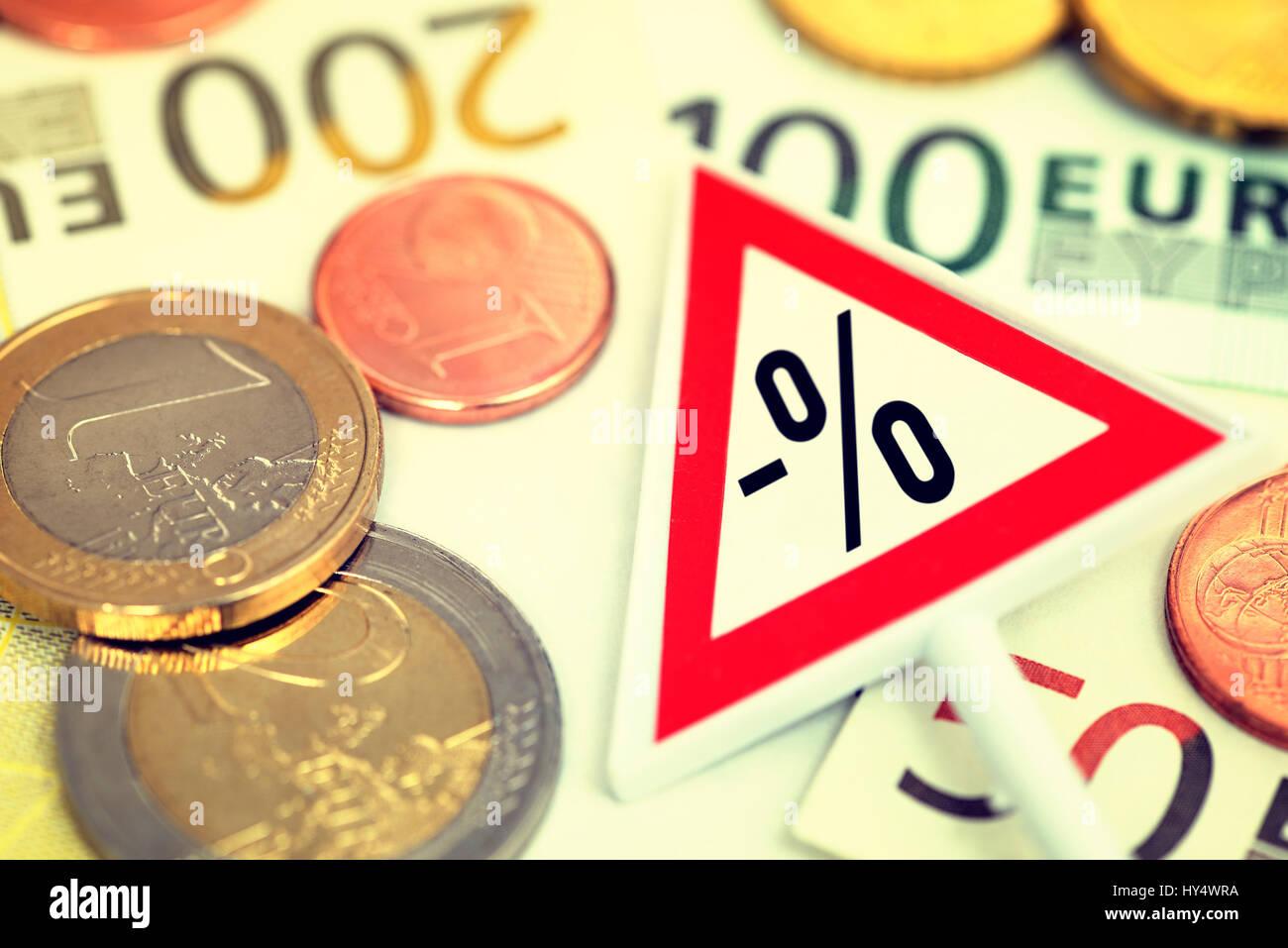 Warning with negative percent sign on bank notes, symbolic photo negative interest, Warnschild mit negativem Prozentzeichen Stock Photo