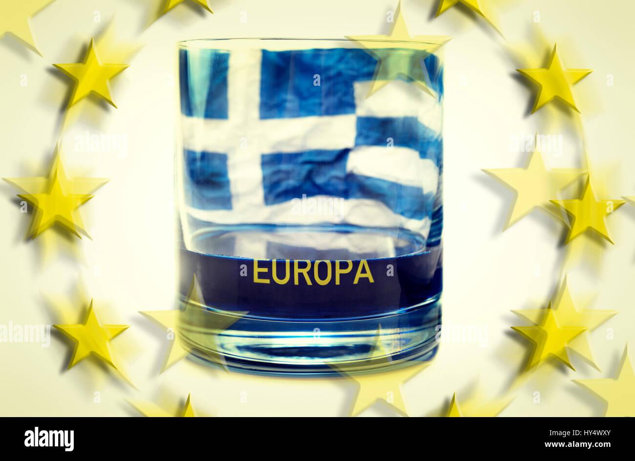 Half-empty glass with Greek flag, symbolic photo debt quarrel, Halbleeres Glas mit griechischer Fahne, Symbolfoto Stock Photo