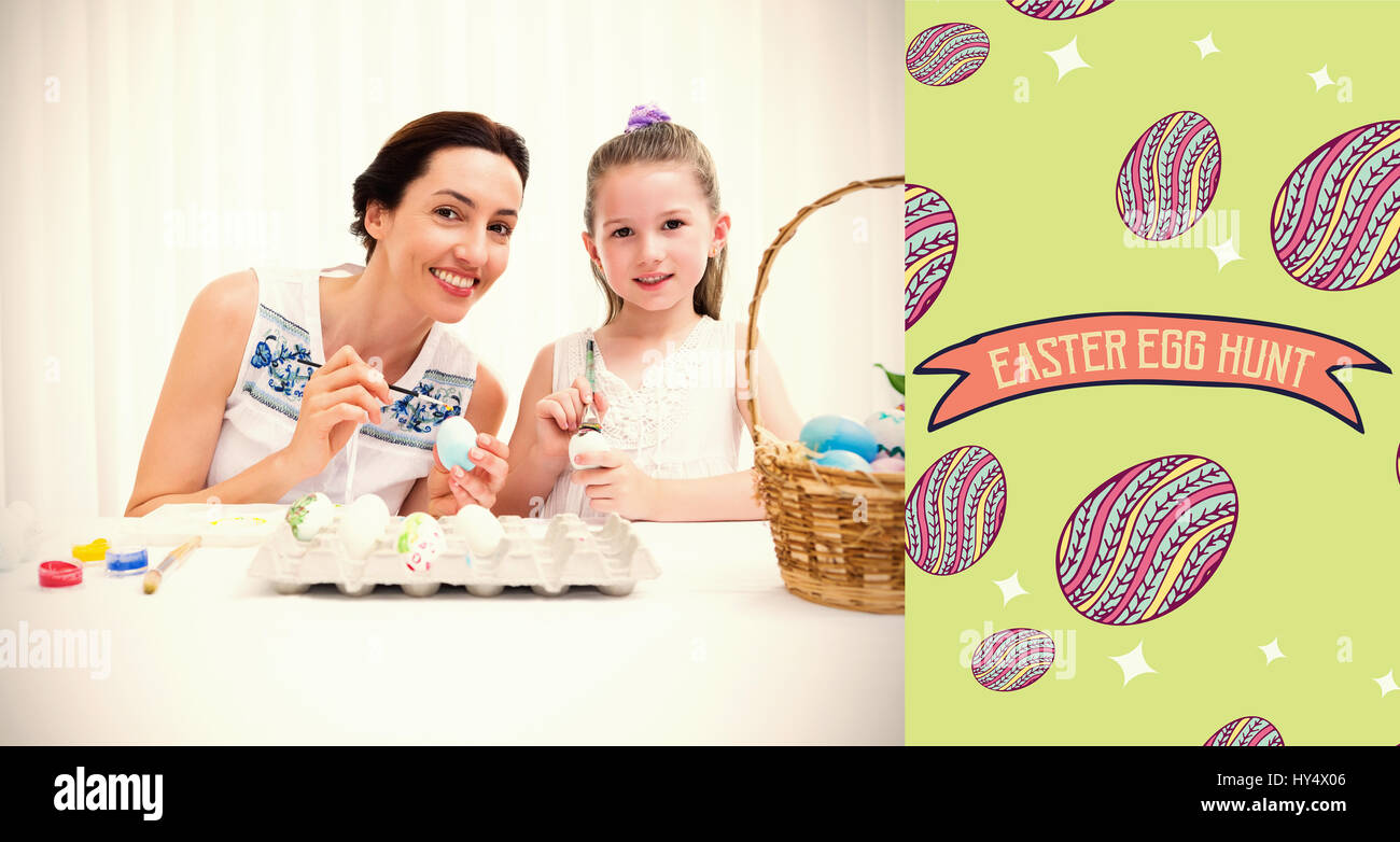 Mother and daughter painting easter eggs against te252 hndr easter ...