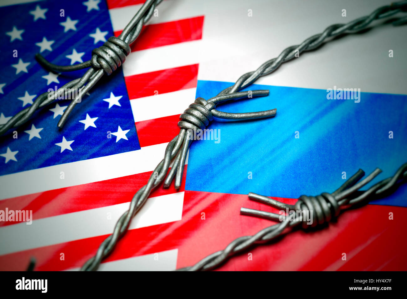 Flags of the USA and Russia with barbed wire, cold war, Fahnen von USA und Russland mit Stacheldraht, Kalter Krieg - Stock Image