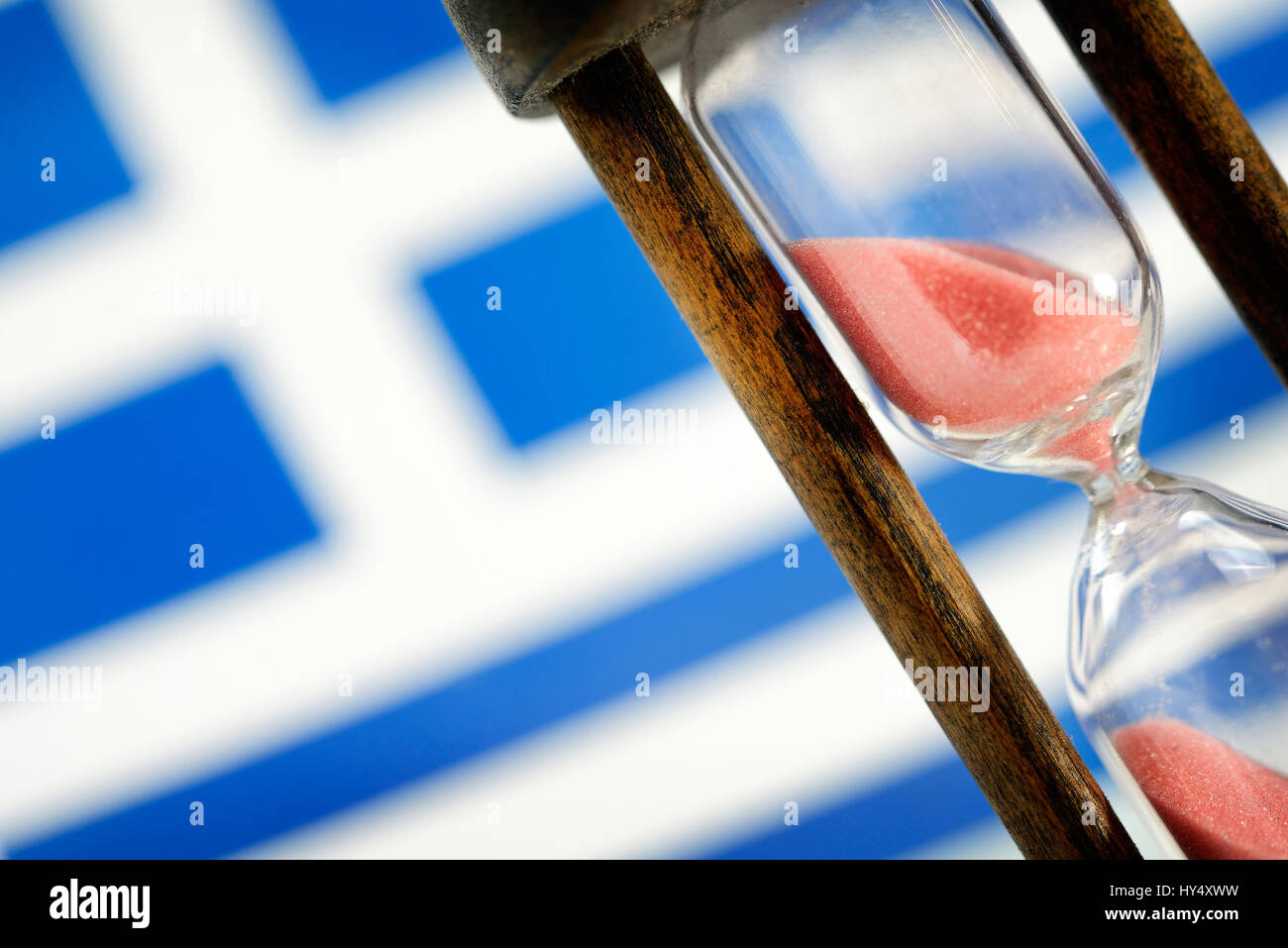 Greek flag and hourglass, symbolic photo Greek debt crisis, Griechische Fahne und Sanduhr, Symbolfoto griechische Stock Photo