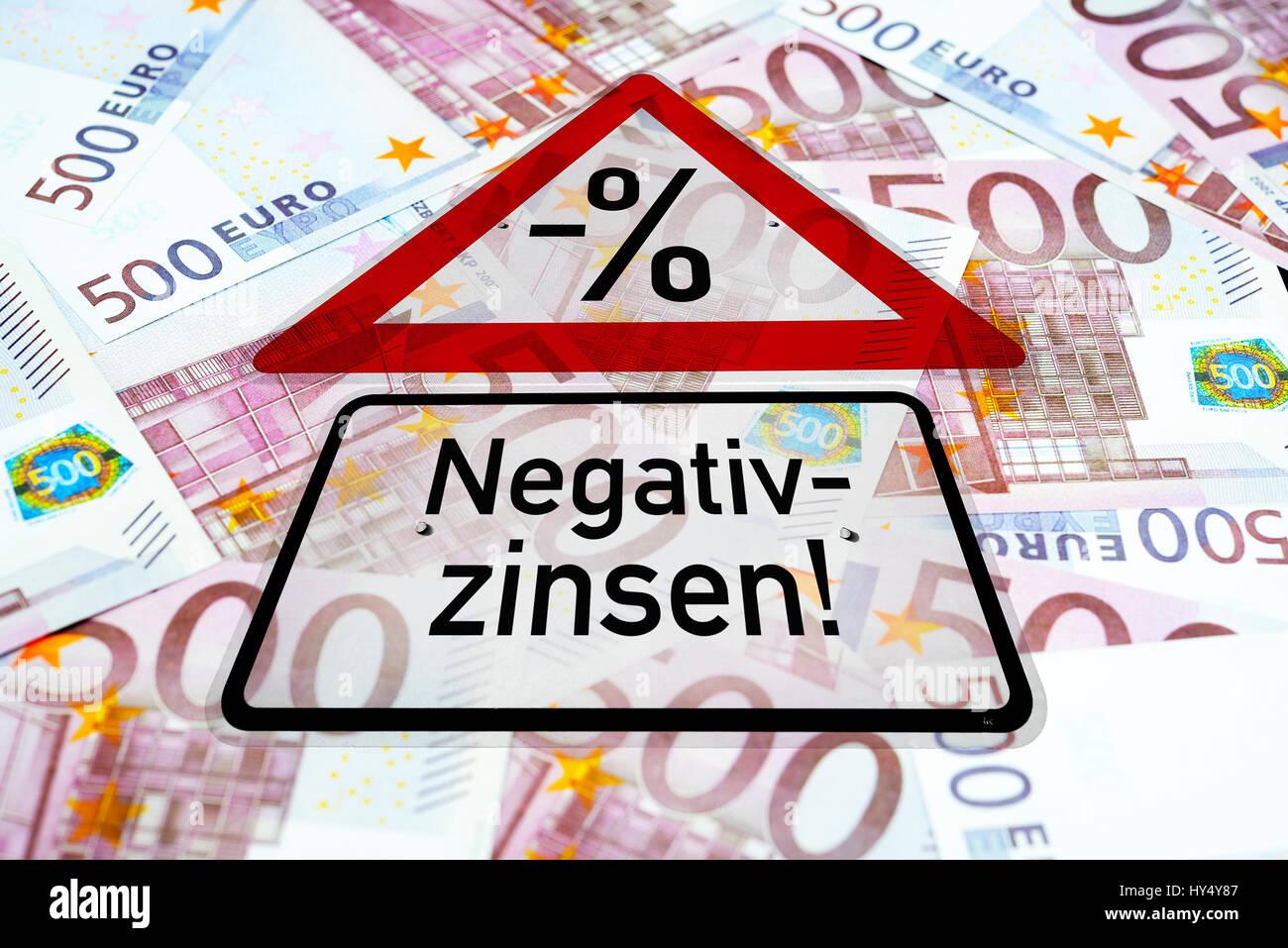 Warning with label Negative interest on 500-euro-bank notes, Warnschild mit Aufschrift Negativzinsen auf 500-Euro Stock Photo