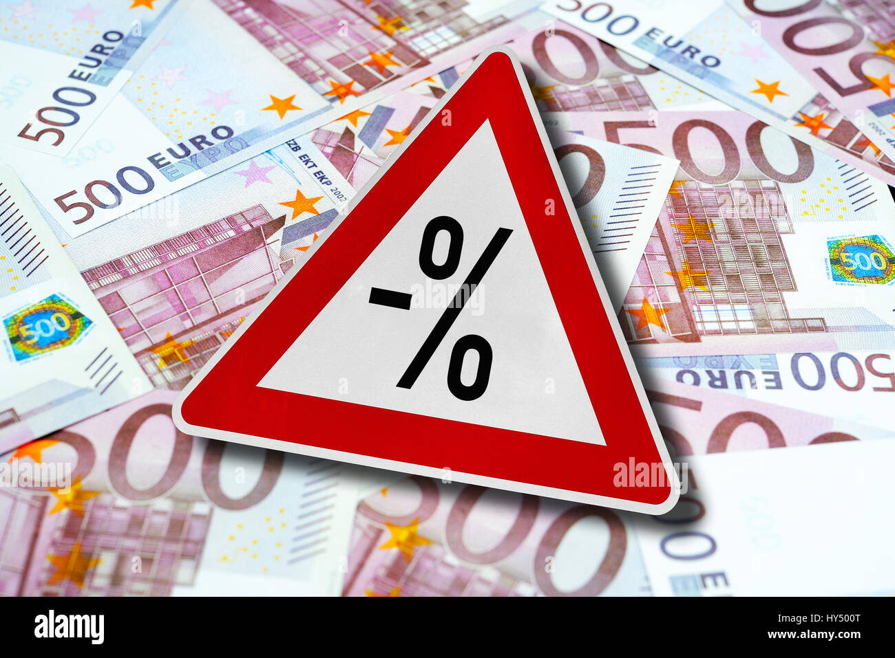 Warning with negative percent sign on 500-euro-bank notes, symbolic photo negative interest, Warnschild mit negativem Stock Photo