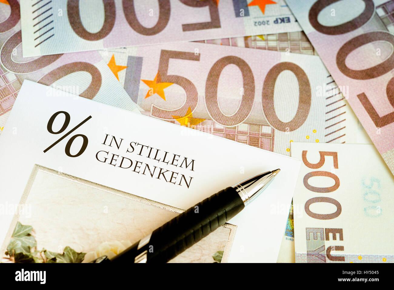 Bank notes and condolence card, symbolic photo negative interest, Geldscheine und Beileidskarte, Symbolfoto Negativzinsen Stock Photo