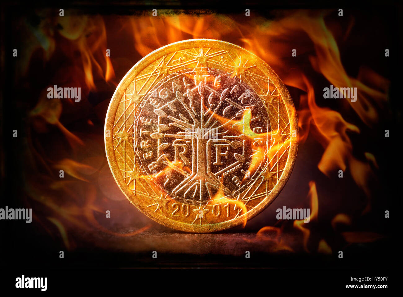 French euro-coin one in flames, eurocrisis, Franzoesische Ein-Euro-Muenze in Flammen, Eurokrise - Stock Image
