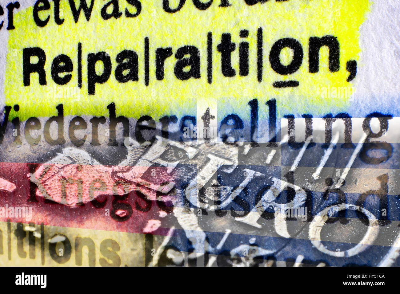 The word Reparation in a dictionary and eurocoin, Greek Reparationsforderungen, Das Wort Reparation in einem Woerterbuch Stock Photo