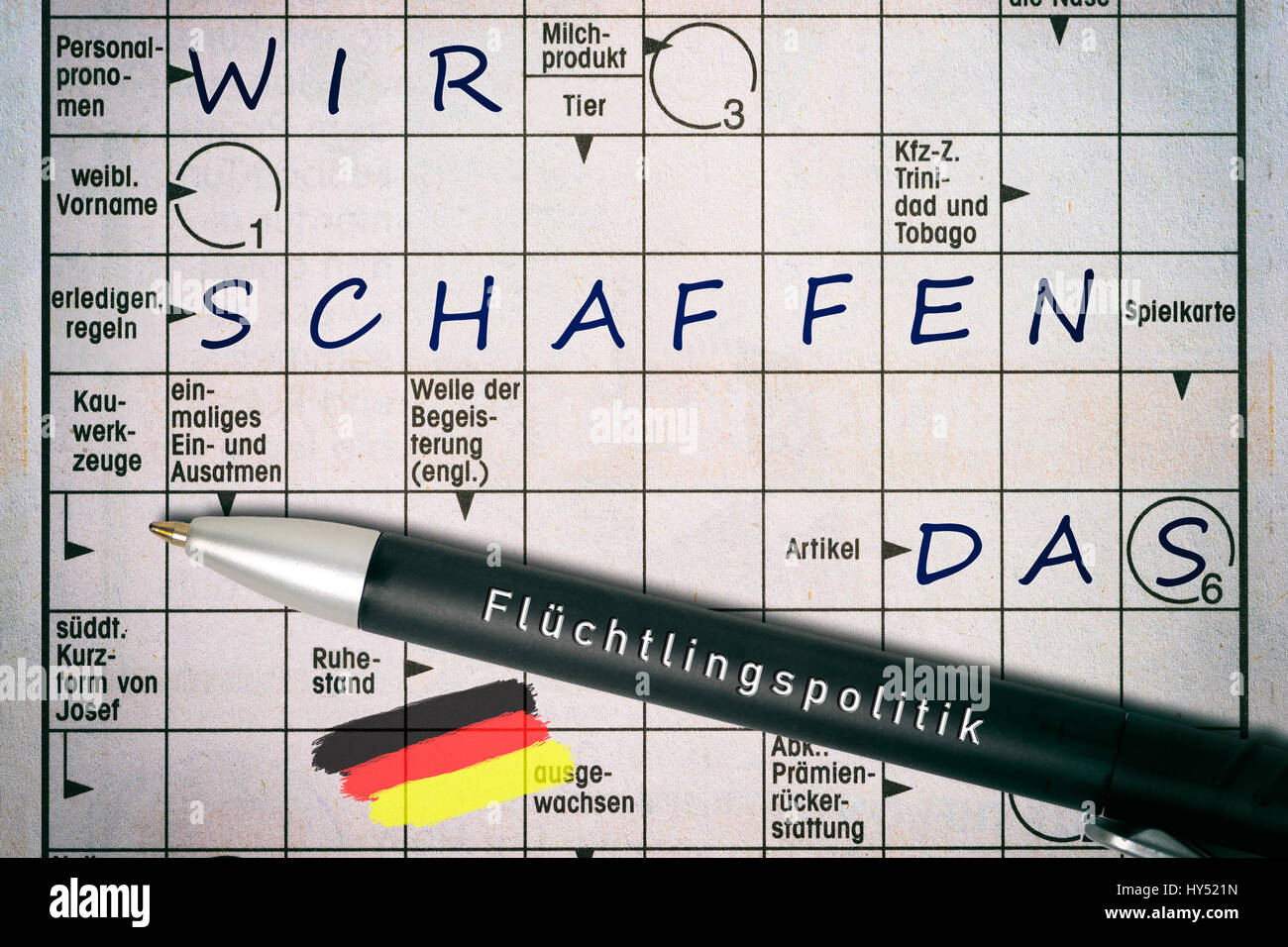 Crossword puzzles with the concepts we, create, the label Refugee policy on a ballpoint pen, Kreuzwortraetsel mit - Stock Image