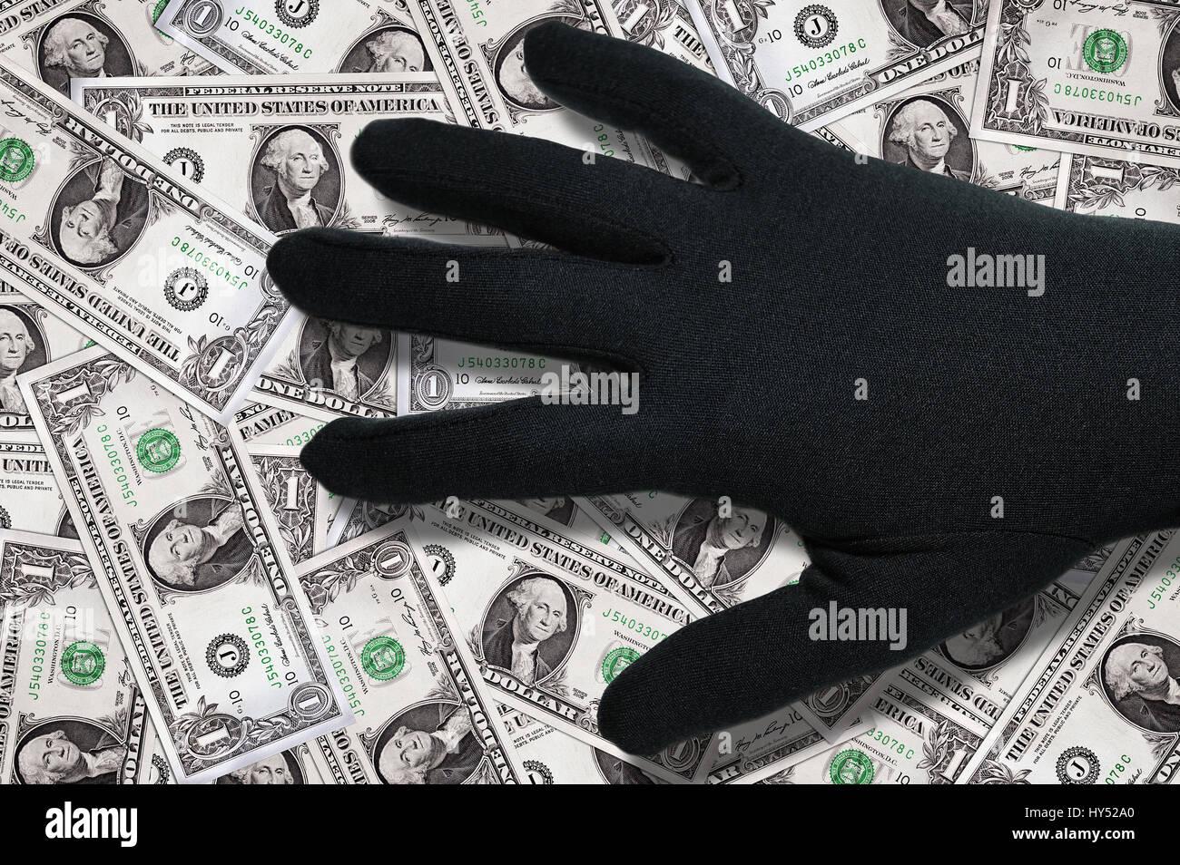 Black hand about dollar marks, Schwarze Hand ueber Dollarnoten Stock Photo