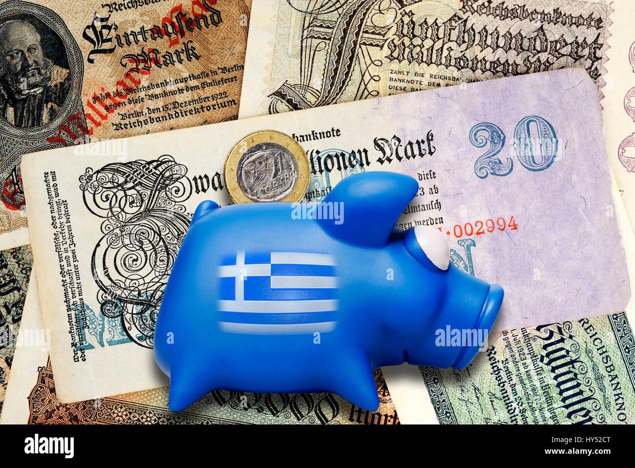 Old German inflation bank notes and Greek piggy bank, Greek Reparationsforderungen, Alte deutsche Inflations-Geldscheine Stock Photo