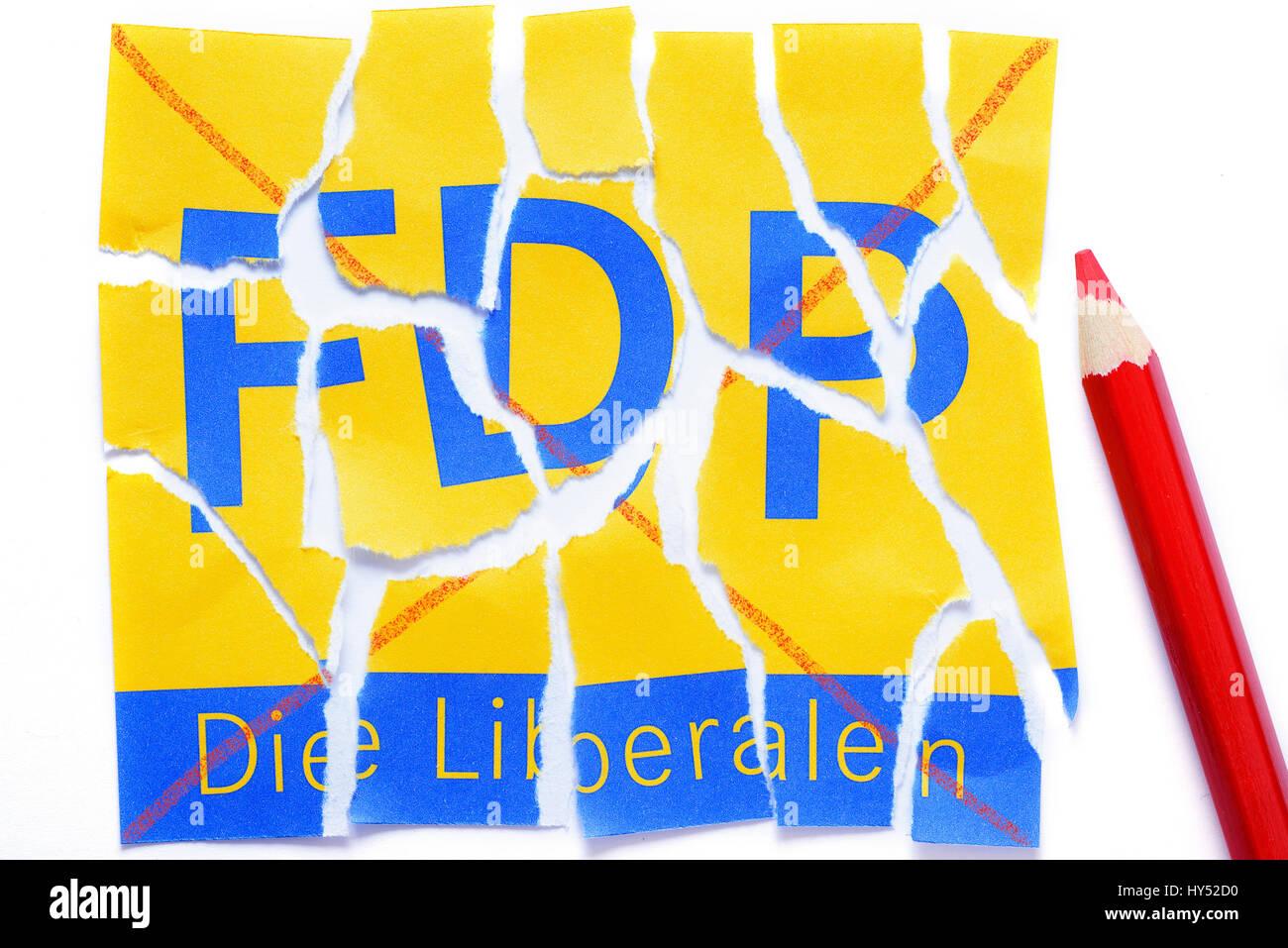 Torn logo of the FDP, symbolic photo losses of votes for the FDP, Zerrissenes Logo der FDP, Symbolfoto Stimmenverluste - Stock Image