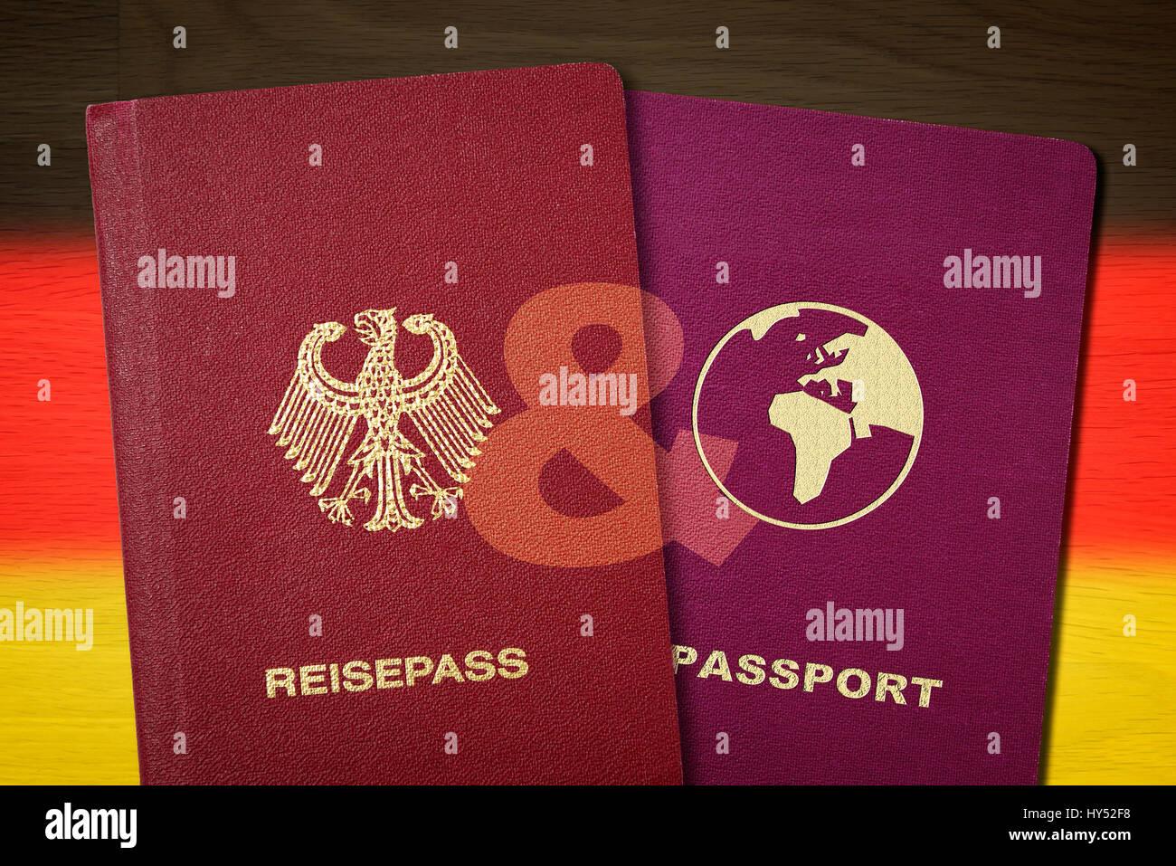 German and second passport before Germany flag, symbolic photo double citizenship, Deutscher und zweiter Pass vor Stock Photo
