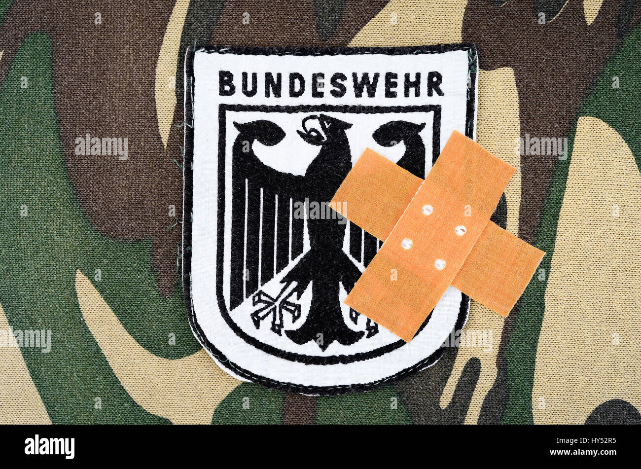Armed forces badges with plaster, symbolic photo equipment faults, Bundeswehr-Abzeichen mit Pflaster, Symbolfoto - Stock Image
