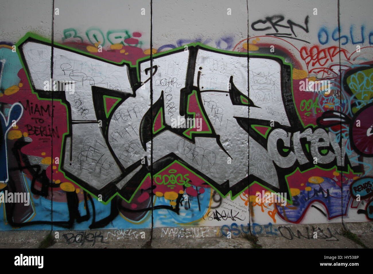 Different photos of graffiti in the historic east and west side of the Berlin wall. - Stock Image