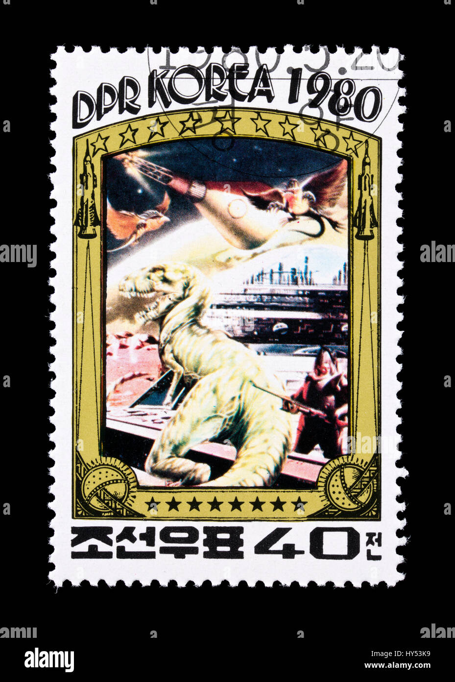 Postage stamp from North Korea depicting spaces and dinosaurs. - Stock Image