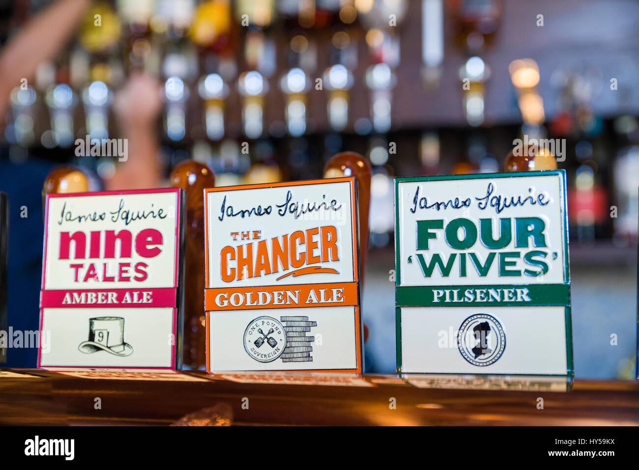 Signs; pub beer pump handles; James Squire, an Australian beer brand. Craft beer; draught beer, draft beer; amber - Stock Image