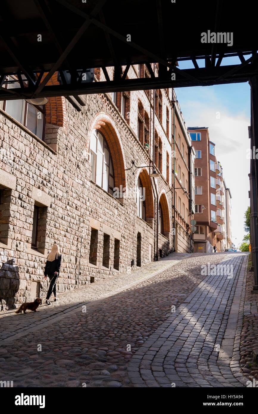 Sweden, Stockholm, Sverige, Sodermalm, City street in shadow - Stock Image