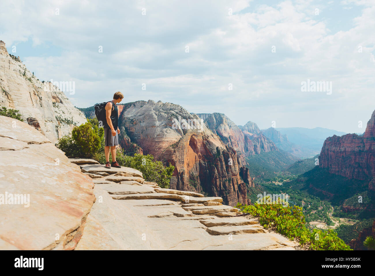 USA, Utah, Man looking at view in Zion National Park - Stock Image