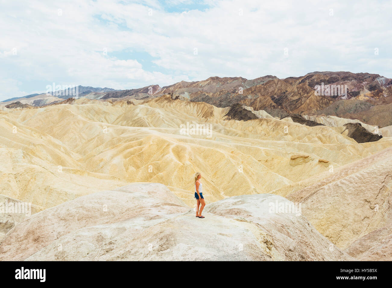 USA, California, Woman looking at view in Death Valley National Park - Stock Image