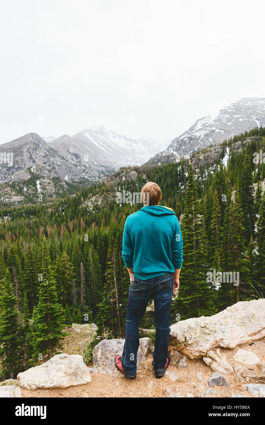 USA, Colorado, Rocky Mountain National Park, Man looking at mountains - Stock Image