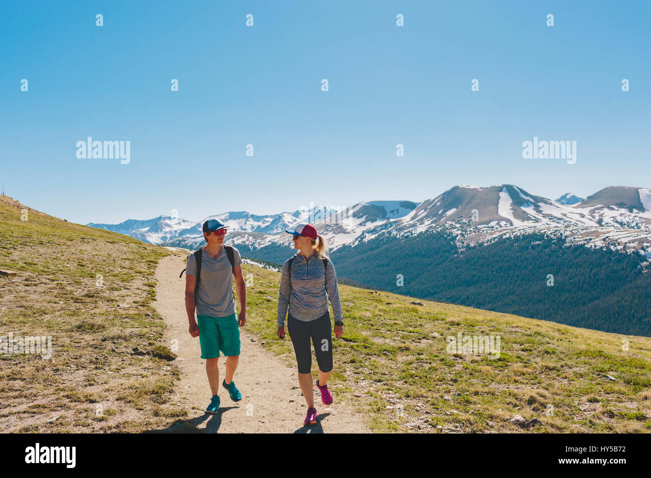 USA, Colorado, Rocky Mountain National Park, Two people hiking in mountains - Stock Image